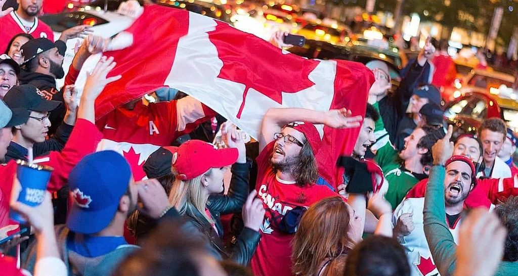 people with a flag on Canadian hockey